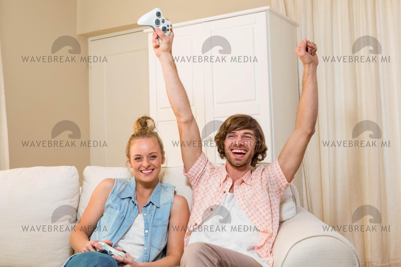 Cute Couple Playing Video Games Sitting On The Couch License Download Or Print For 12 40 Photos Picfair