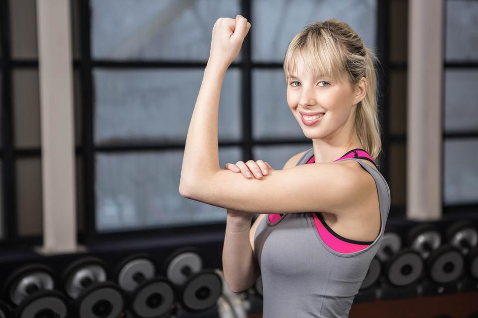 """""""Fit blonde showing biceps"""" stock image"""