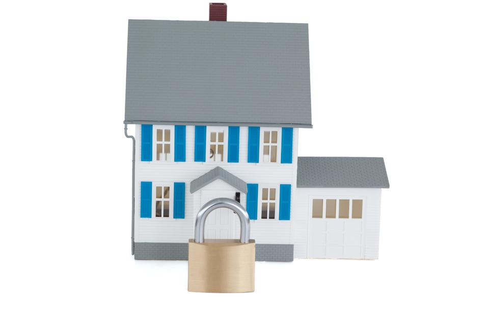 """""""Secured gray house against a white background"""" stock image"""