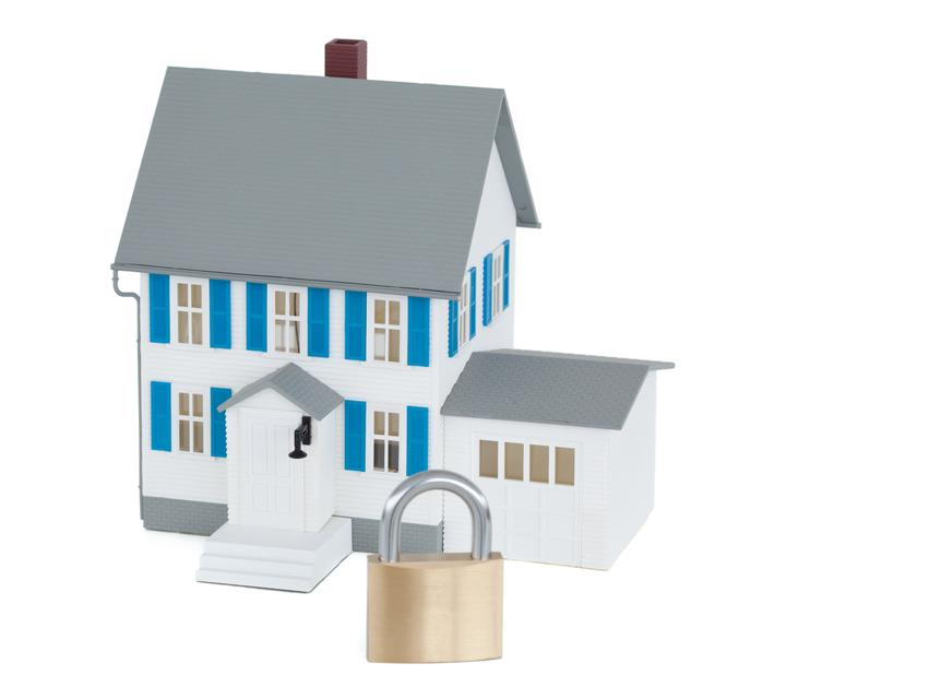 """""""Secured grey house against a white background"""" stock image"""