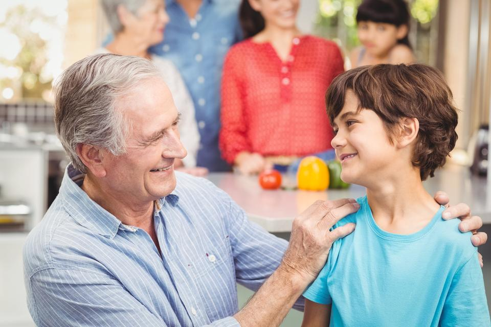 """""""Happy grandfather and grandson with family"""" stock image"""