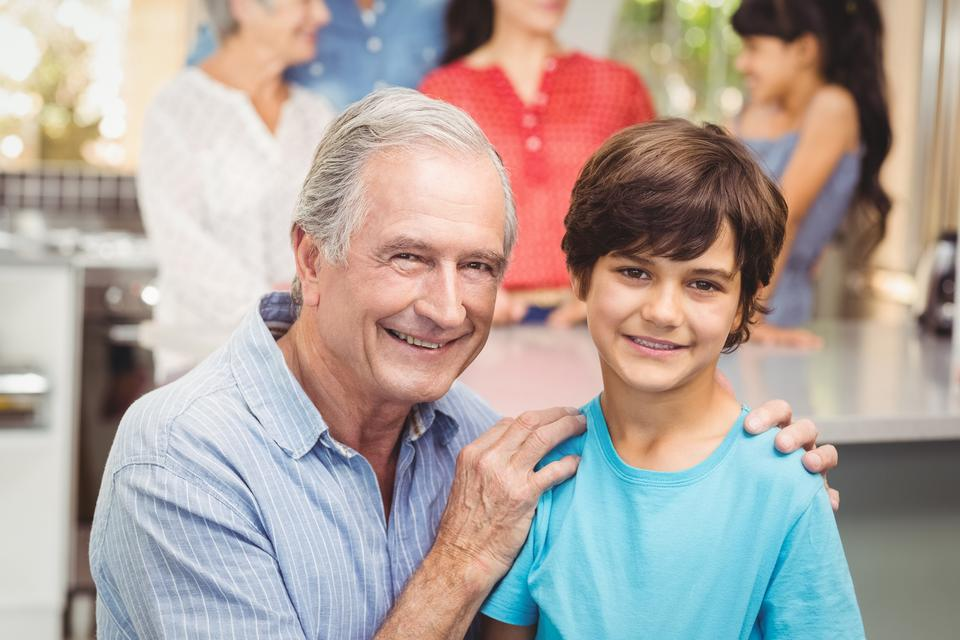 """""""Portrait of grandfather and grandson with family"""" stock image"""