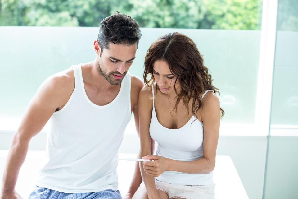 """""""Woman showing pregnancy test to husband"""" stock image"""