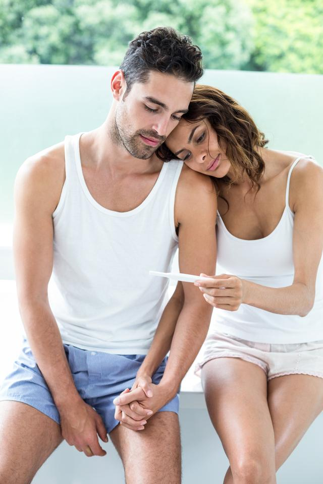 """""""Wife showing pregnancy test to husband"""" stock image"""