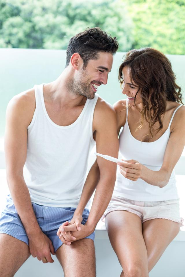 """""""Happy couple with pregnancy test"""" stock image"""