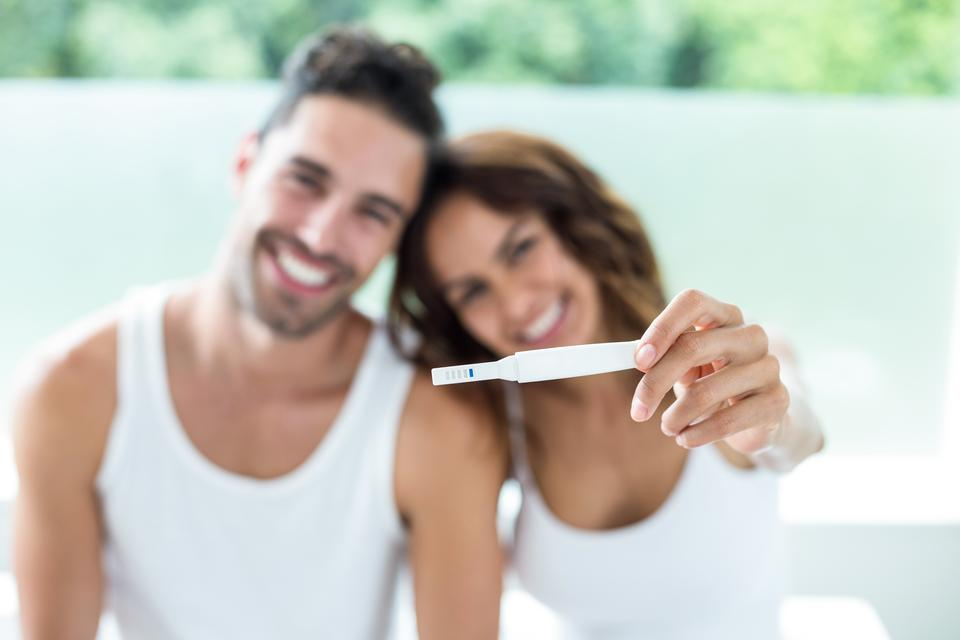 """""""Happy couple showing pregnancy kit"""" stock image"""