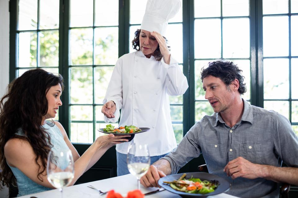 """""""Couple complaining about the food to chef"""" stock image"""