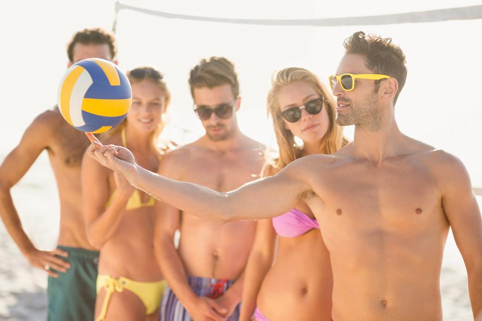 """Friends playing beach volley"" stock image"