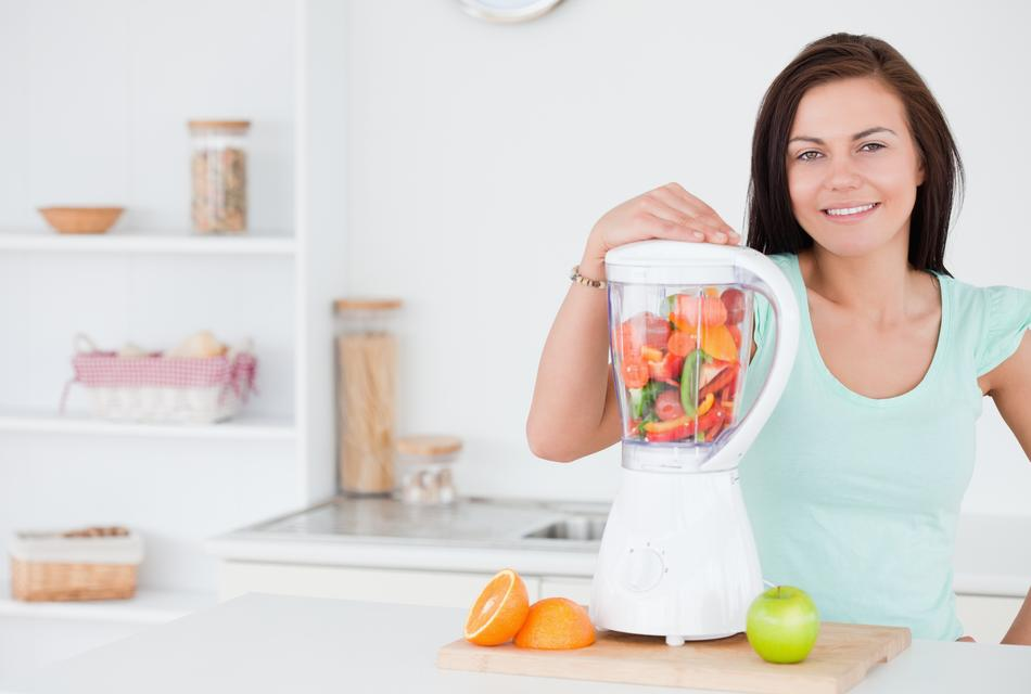 """Darkhaired woman posing with a blender"" stock image"