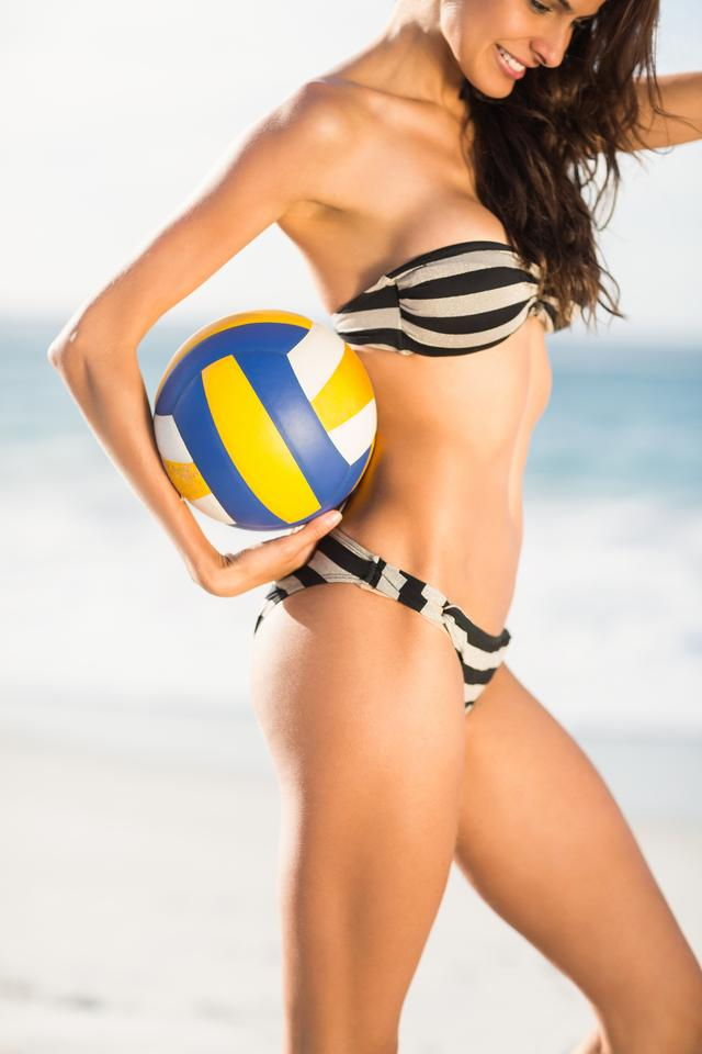 """Woman holding volley ball"" stock image"