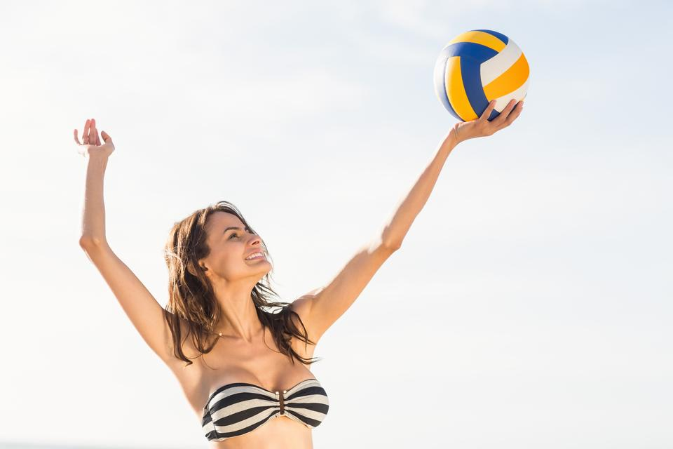 """Woman playing beach volley"" stock image"