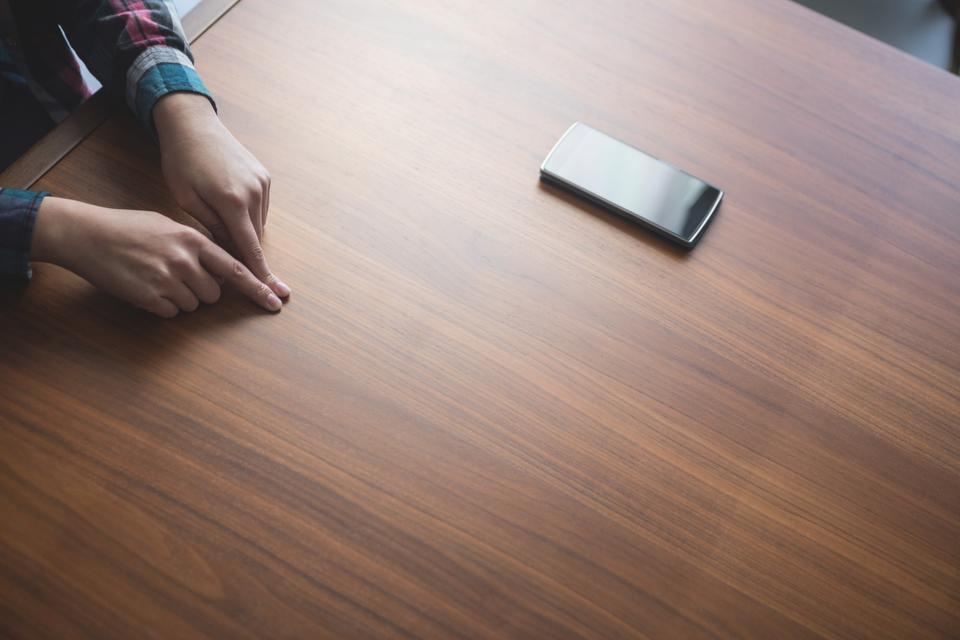 """""""Woman placing her index fingers on a table"""" stock image"""