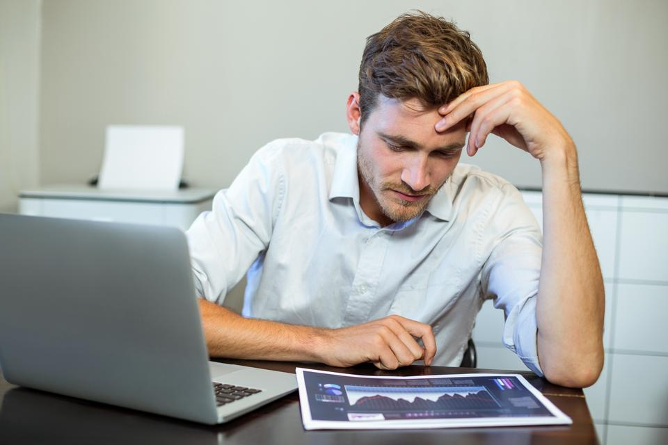 """""""Frustrated businessman sitting in office"""" stock image"""