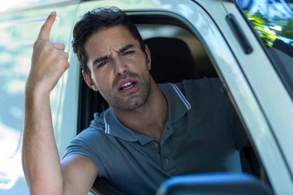 """Portrait of irritated young man pointing"" stock image"