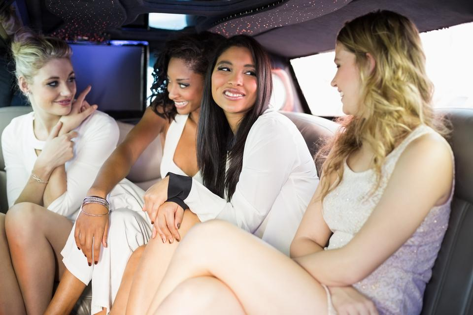 """Well dressed women in a limousine"" stock image"