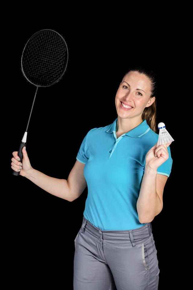 """Badminton player holding badminton racket and shuttlecock"" stock image"