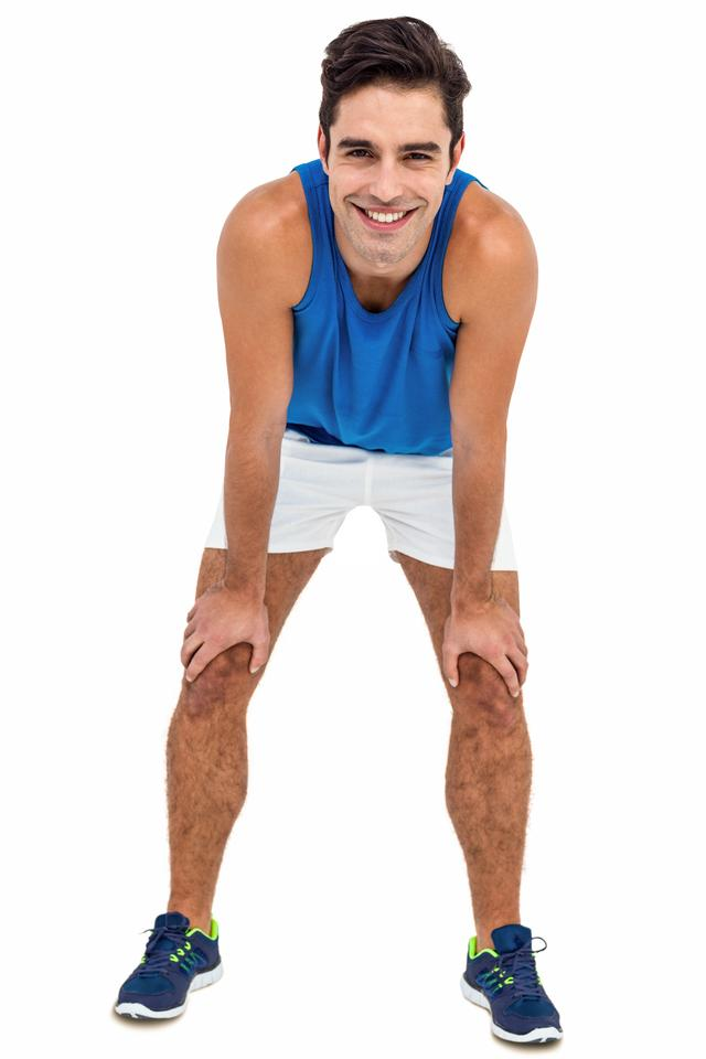 """""""Male athlete standing with hand on knee"""" stock image"""