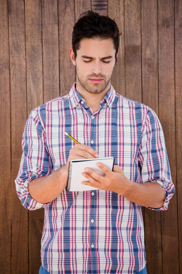 """Man writing in a diary"" stock image"