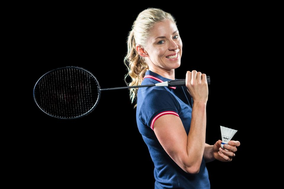 """Badminton player holding racket and shuttlecock"" stock image"