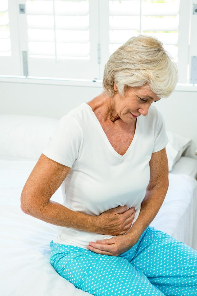 """""""Senior woman suffering from stomach ache"""" stock image"""