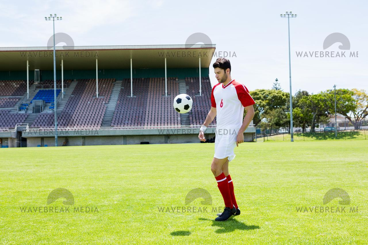 """""""Football player juggling the football with his feet"""" stock image"""