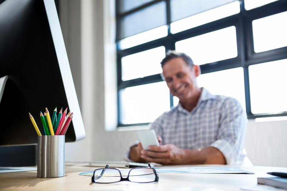 """""""Spectacle and pen holder on desk"""" stock image"""