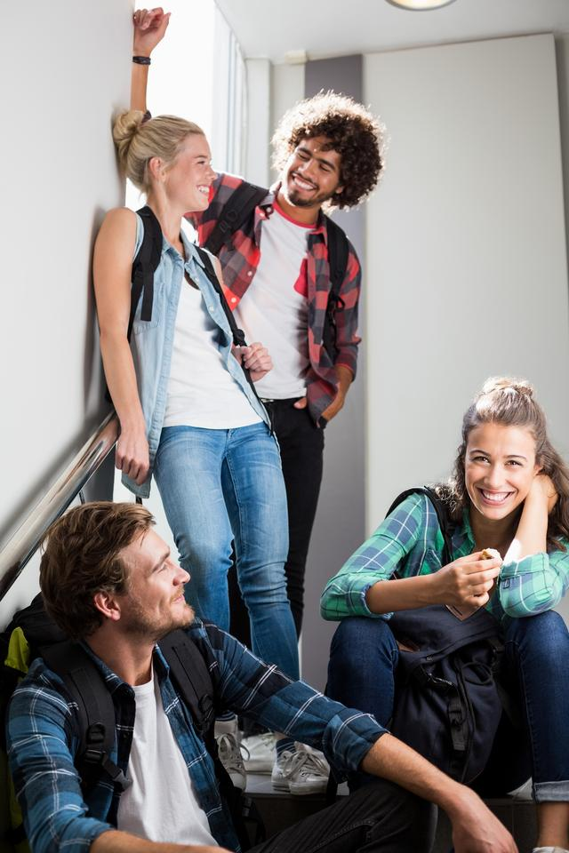 """""""Friends interacting on staircase"""" stock image"""