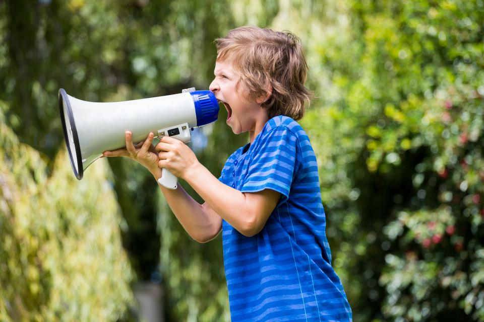 """A little boy is screaming with a megaphone"" stock image"