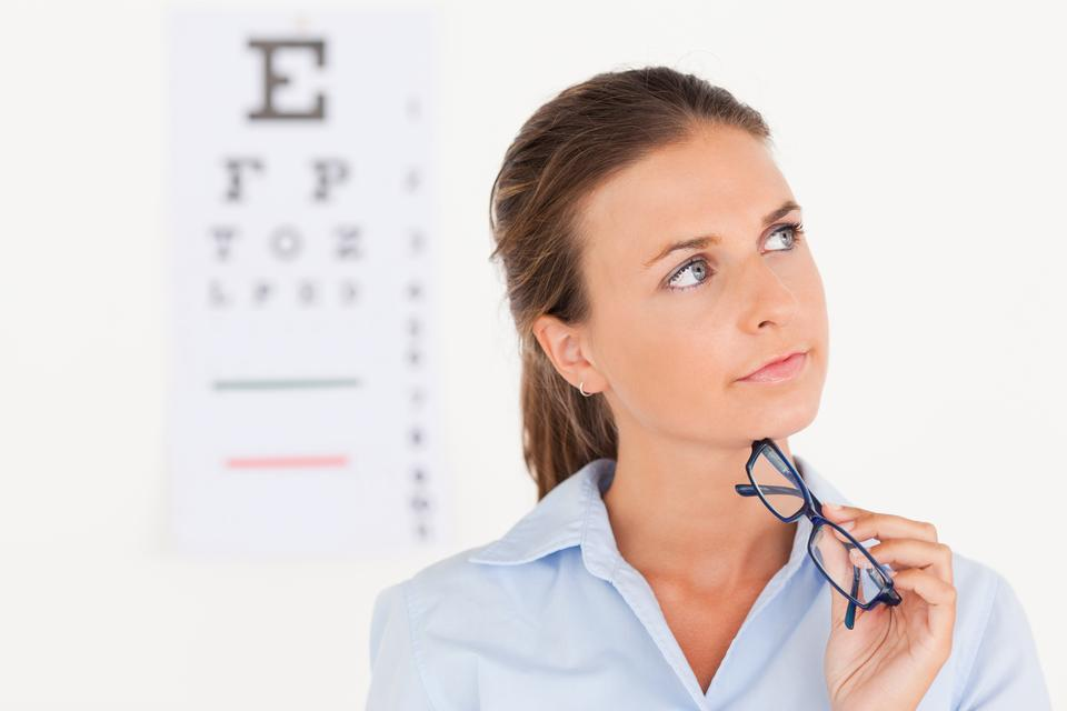 """Thinking eye specialist holding glasses"" stock image"
