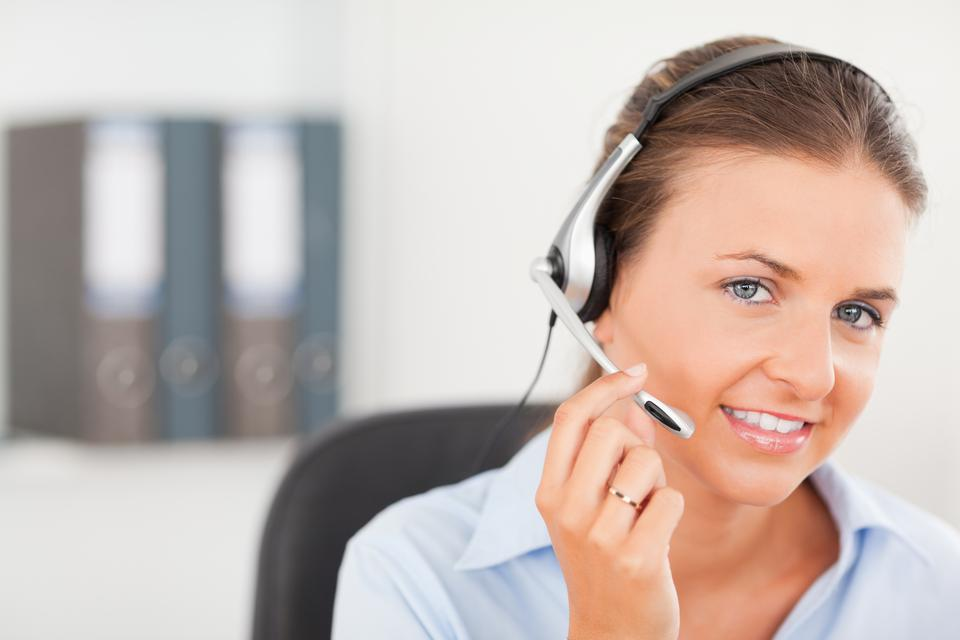 """""""An operator supporting a customer"""" stock image"""