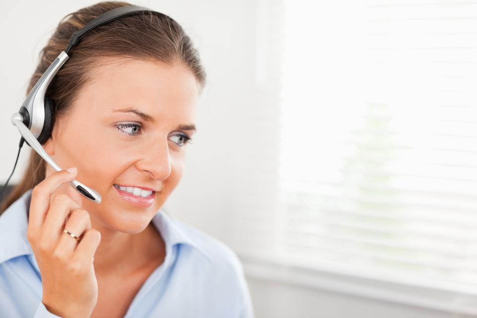 """""""An operator is using a headset"""" stock image"""