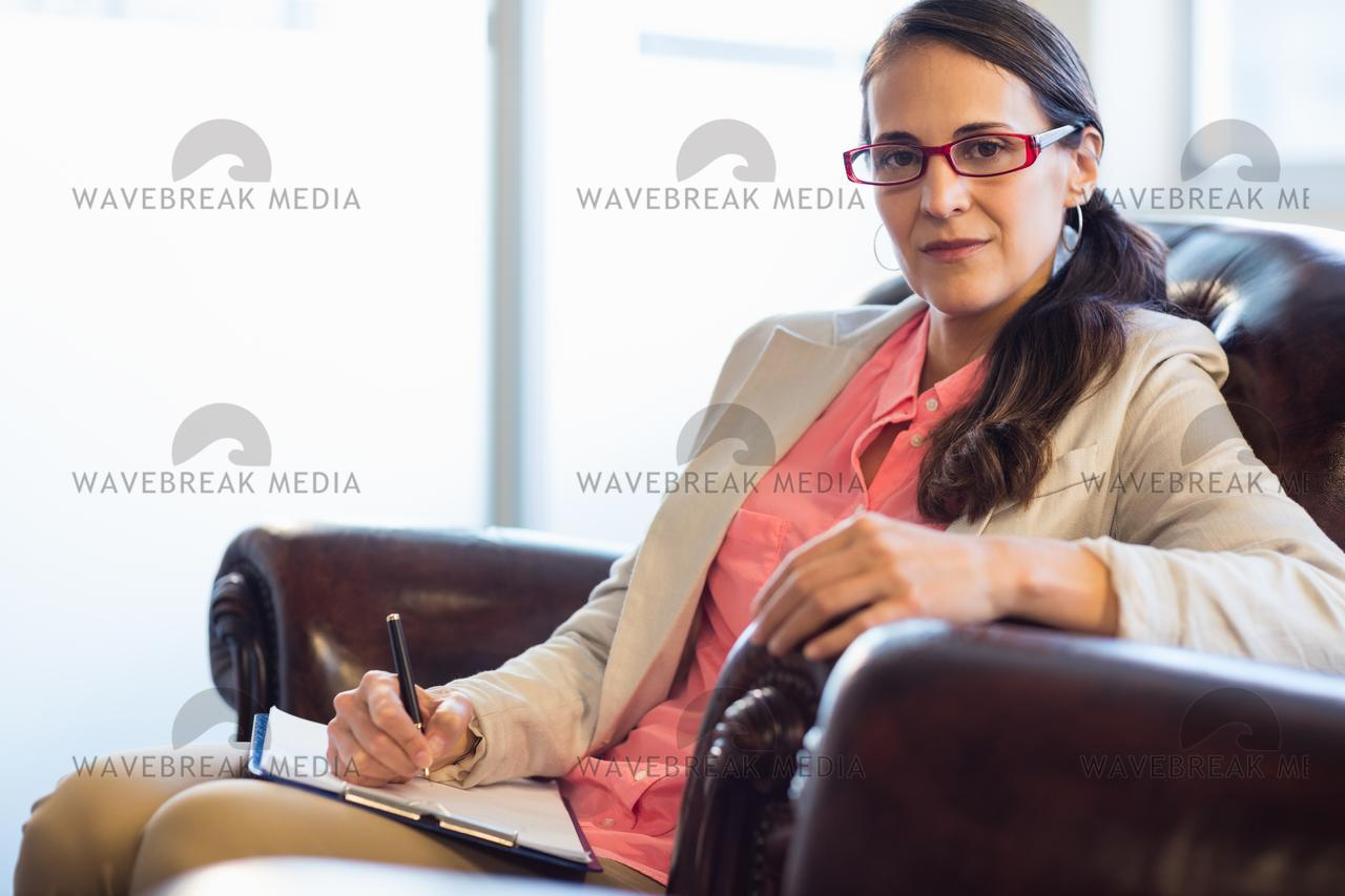 Woman psychologist sitting down - License, download or print