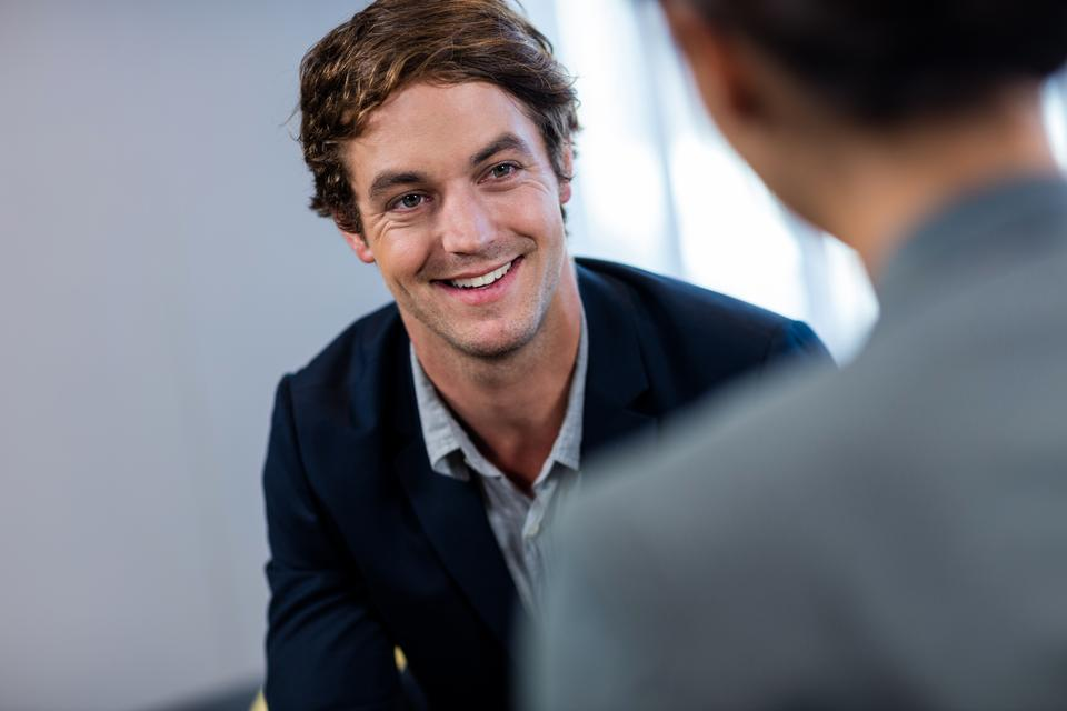 """""""Businessman smiling and interacting"""" stock image"""