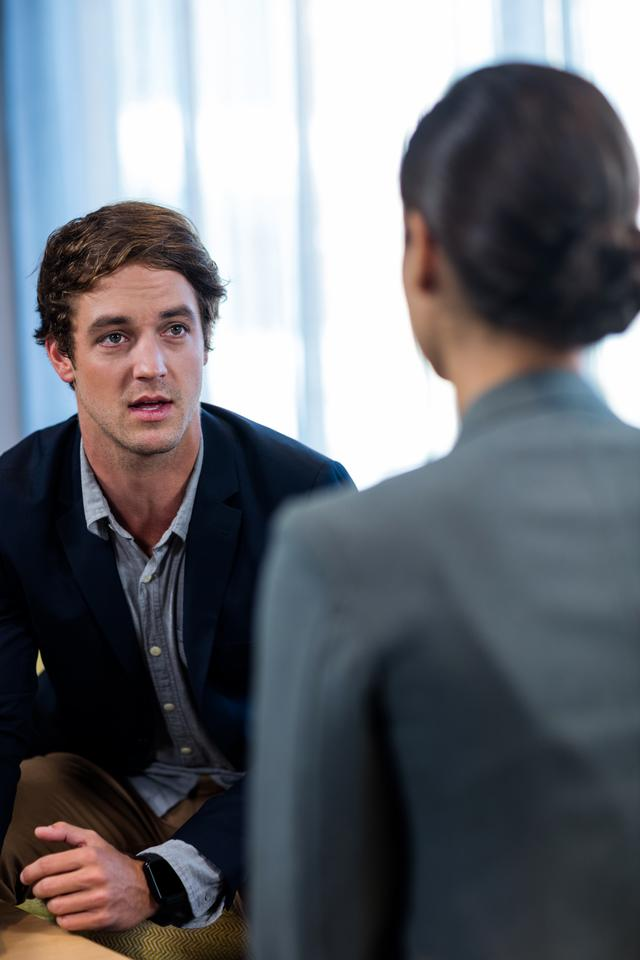 """""""Businessman interacting with a businesswoman"""" stock image"""