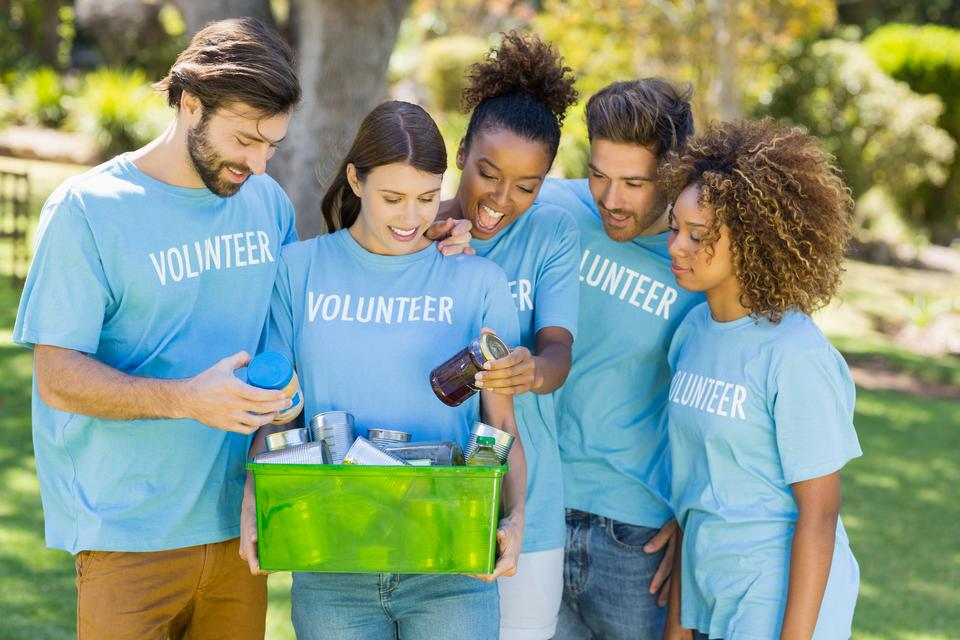 """""""Group of volunteer holding box"""" stock image"""