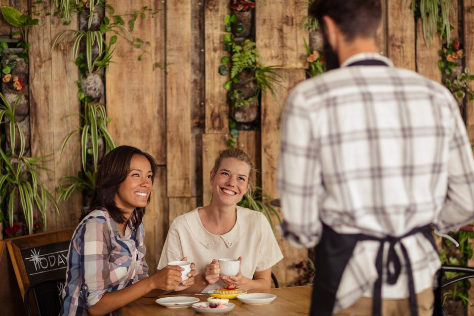 """""""Waiter interacting with customers"""" stock image"""