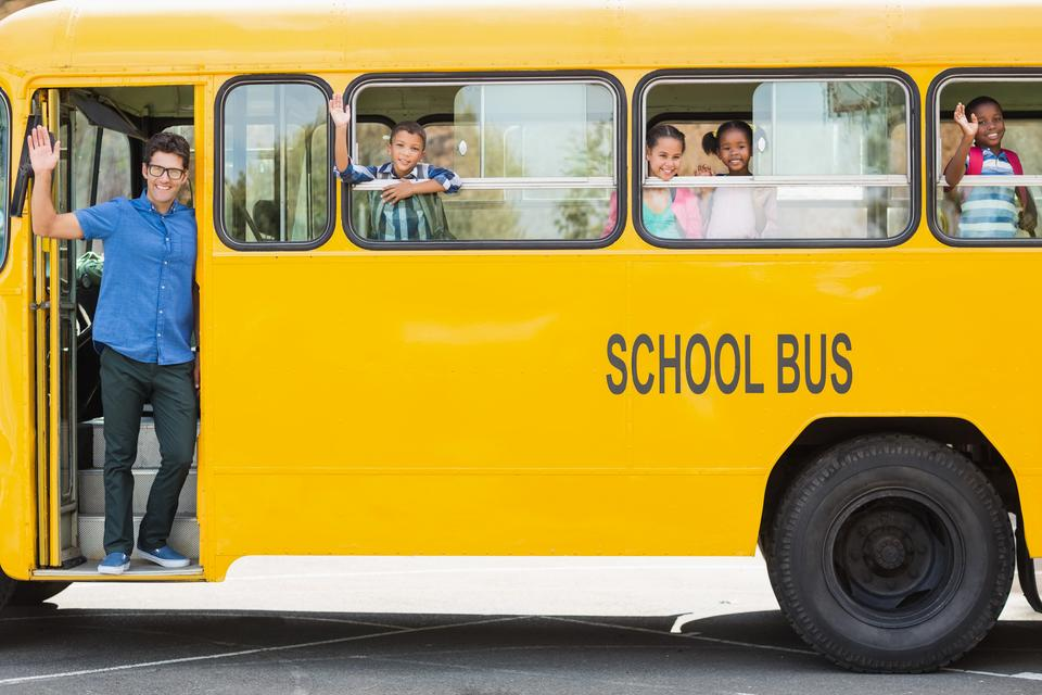 """""""Portrait of teacher and kids waving hand from bus"""" stock image"""