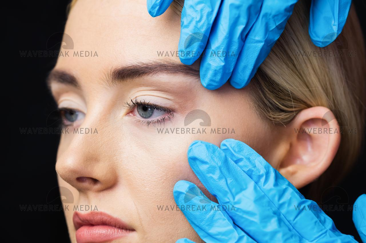 """Woman has an examination of her skin before injection"" stock image"