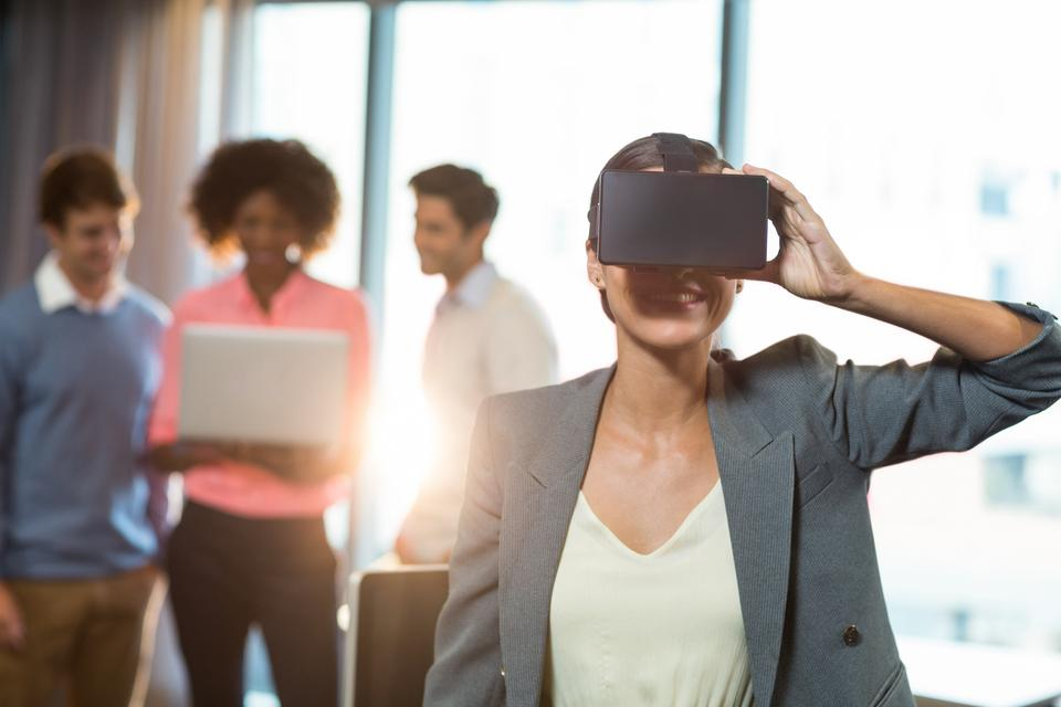"""Businesswoman wearing virtual glasses"" stock image"