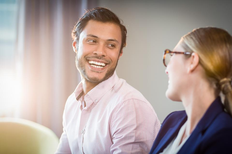 """""""Businesswoman interacting with a colleague"""" stock image"""