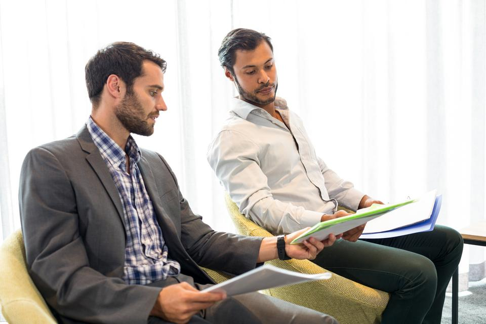 """""""Businessman interacting with coworker"""" stock image"""