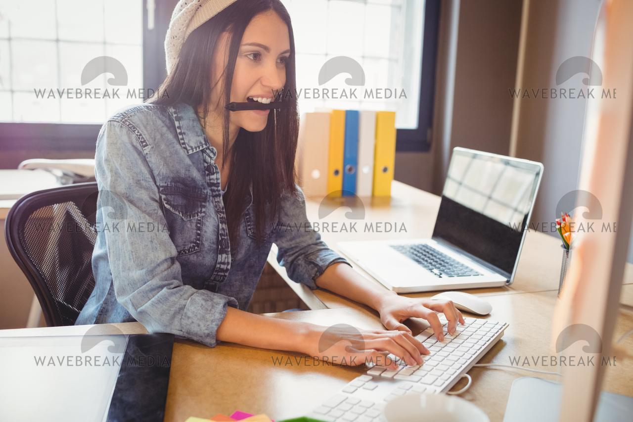 """Graphic designer working on computer"" stock image"