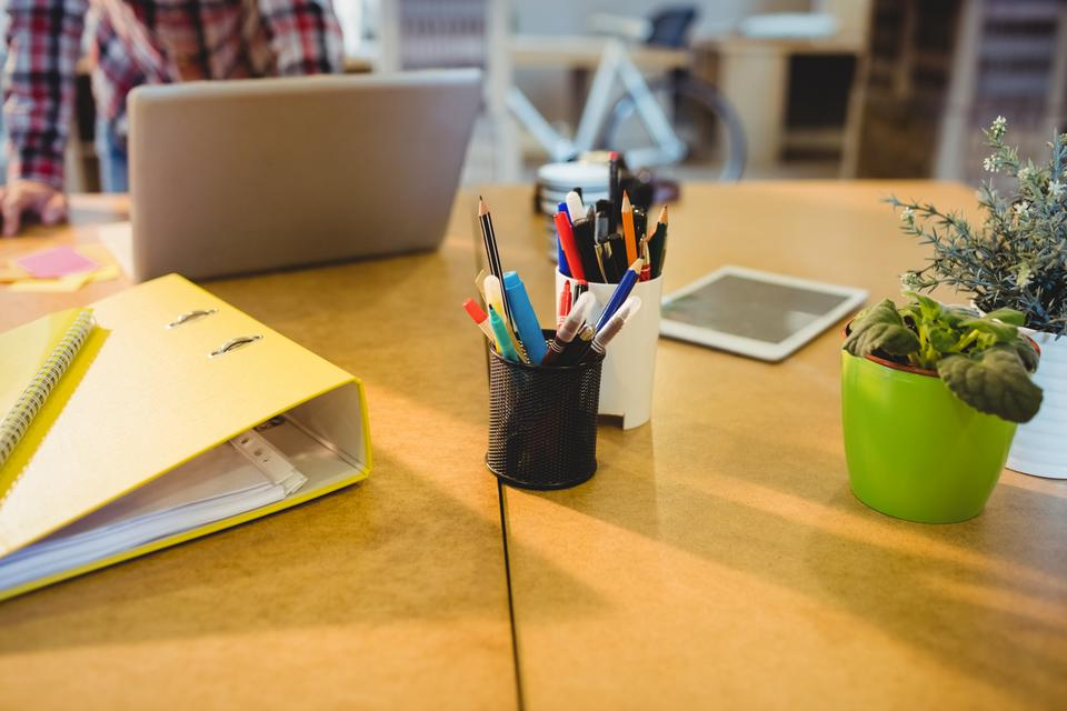 """""""Pen holder with pens and file on table"""" stock image"""