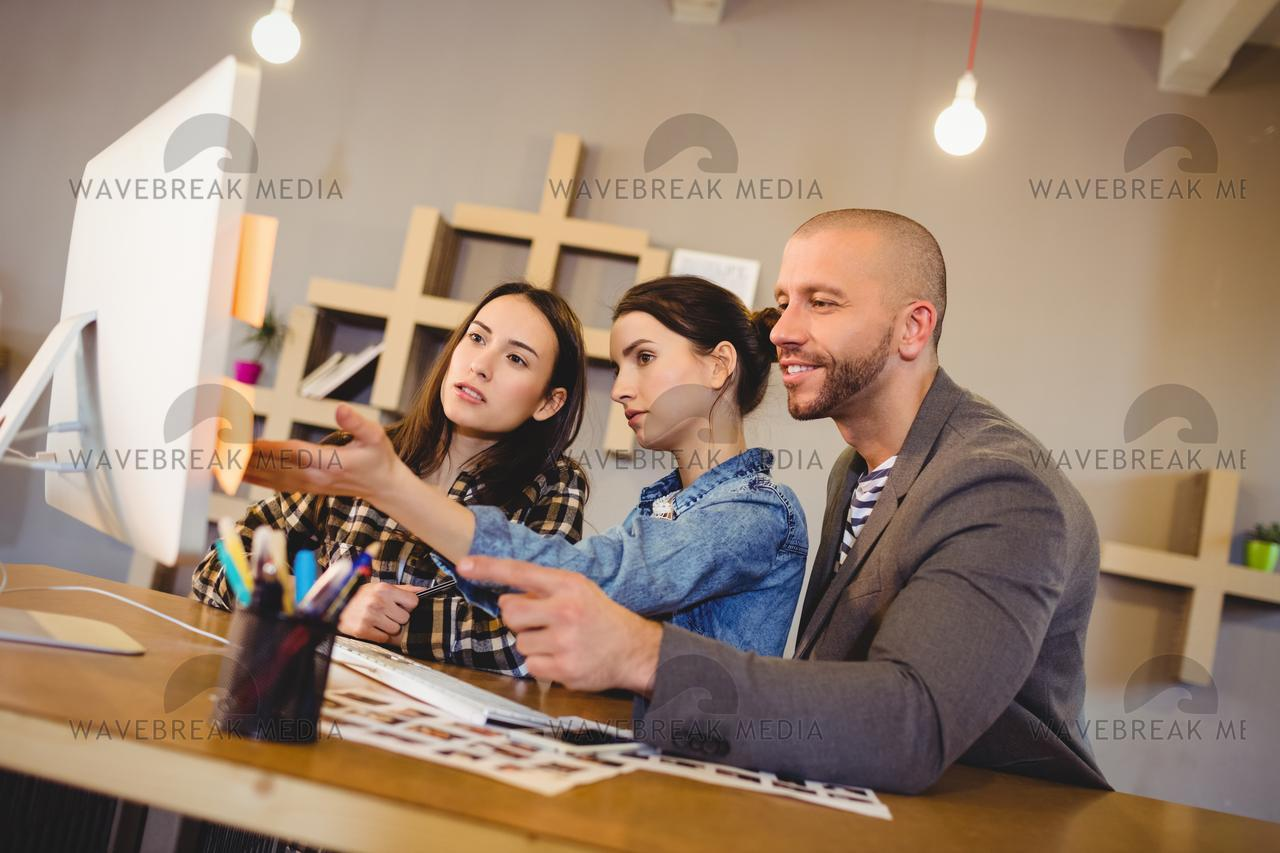 """Team of graphic designer working on computer"" stock image"
