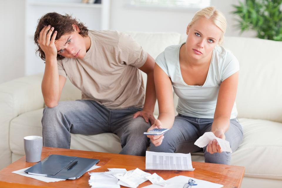 """""""Worried couple calculating expenses"""" stock image"""