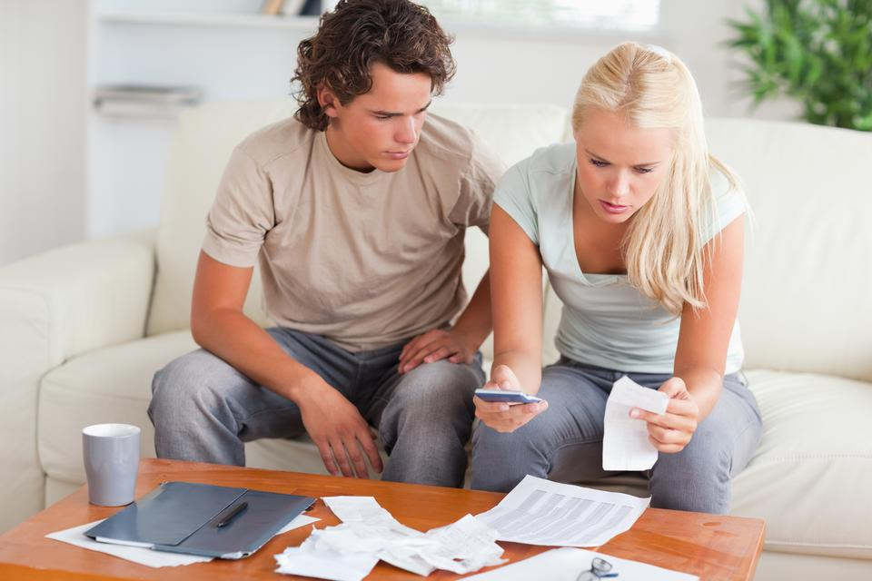 """""""Shocked couple calculating their expenses"""" stock image"""