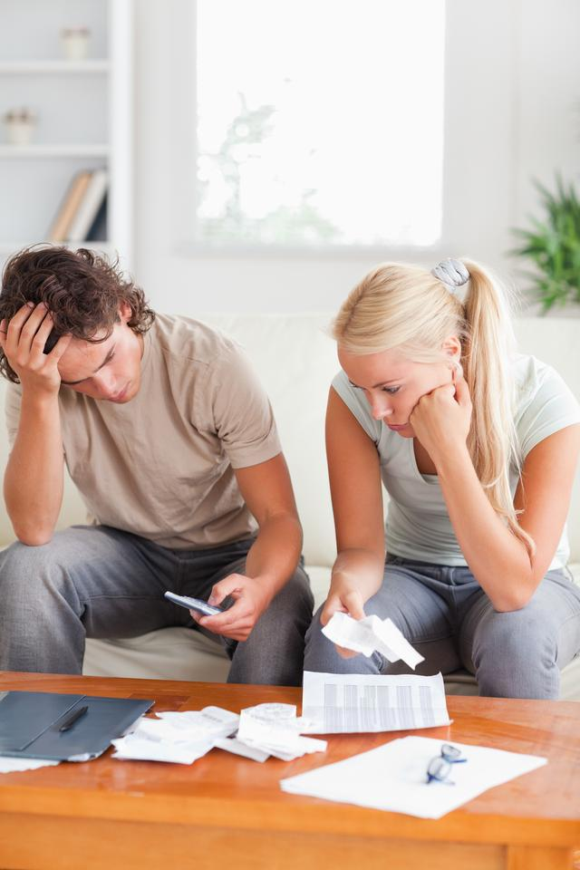 """""""Calculating couple on a sofa"""" stock image"""