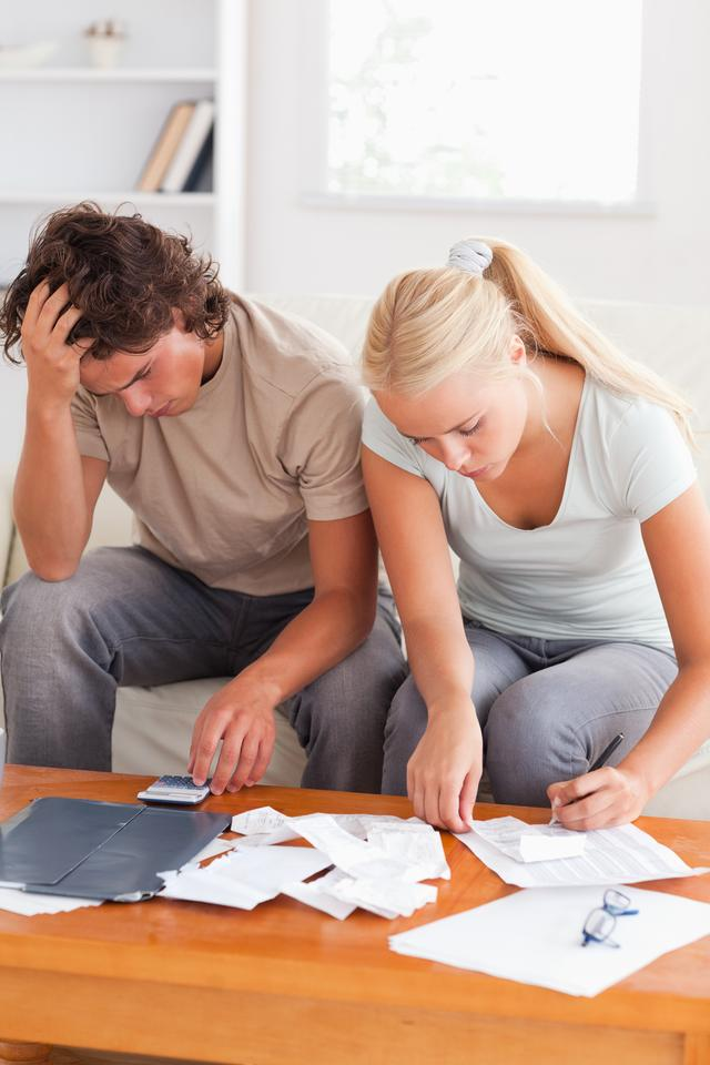 """""""Despaired couple calculating their expenses"""" stock image"""
