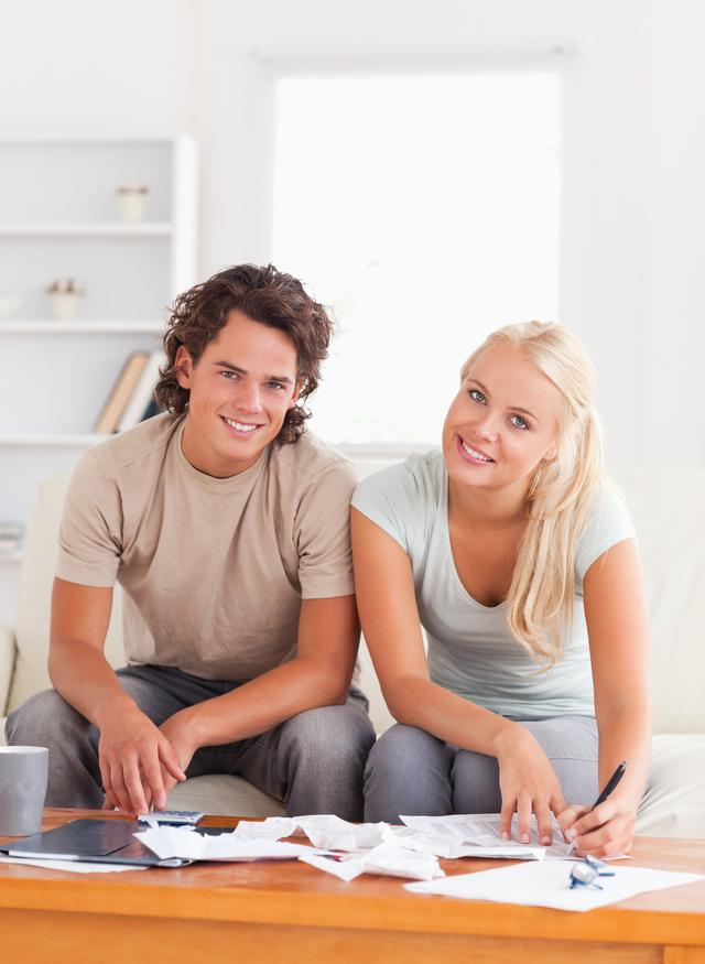 """""""Happy couple calculating"""" stock image"""