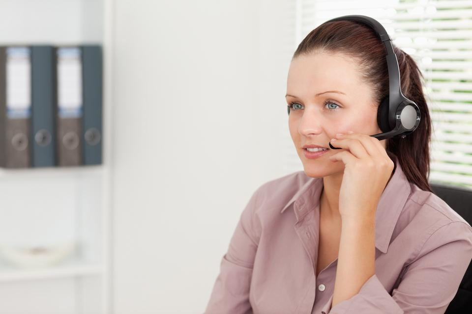 """""""An operator with headset in an office"""" stock image"""